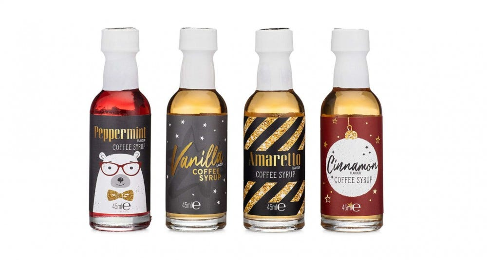 Bottles of Peppermint, Vanilla, Amaretto and Cinnamon syrups from the Gourmet Coffee Toppings Set.