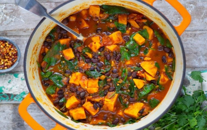 A pot full of sweet potato and black bean stew.