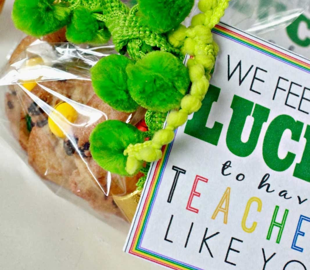 A cookie craft with green pom poms attached.