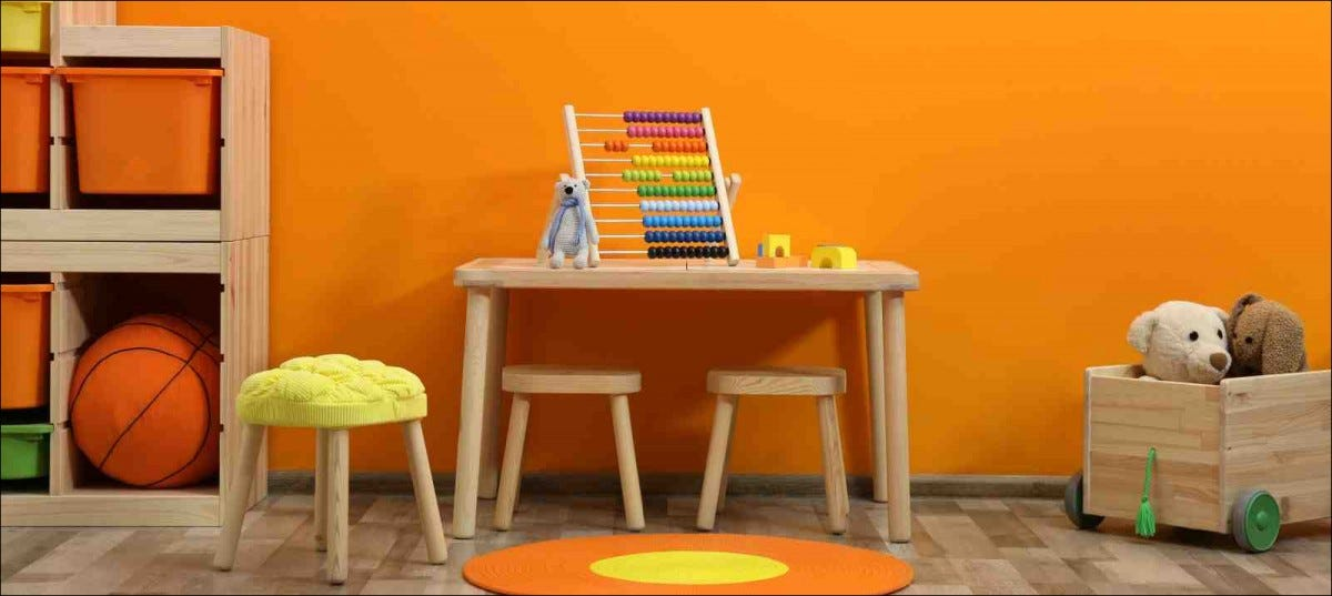 kid's playroom with orange walls