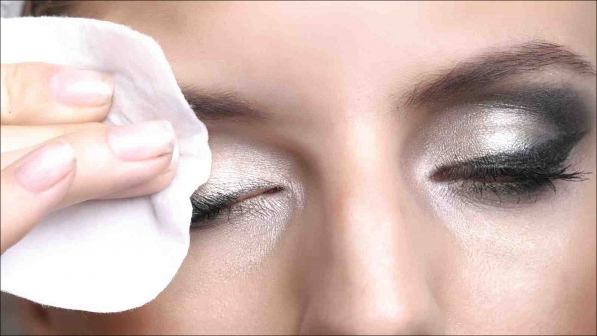 woman Removing makeup with cotton