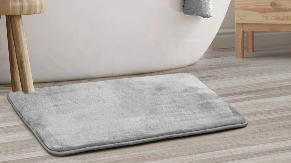 bath mat in front of tub