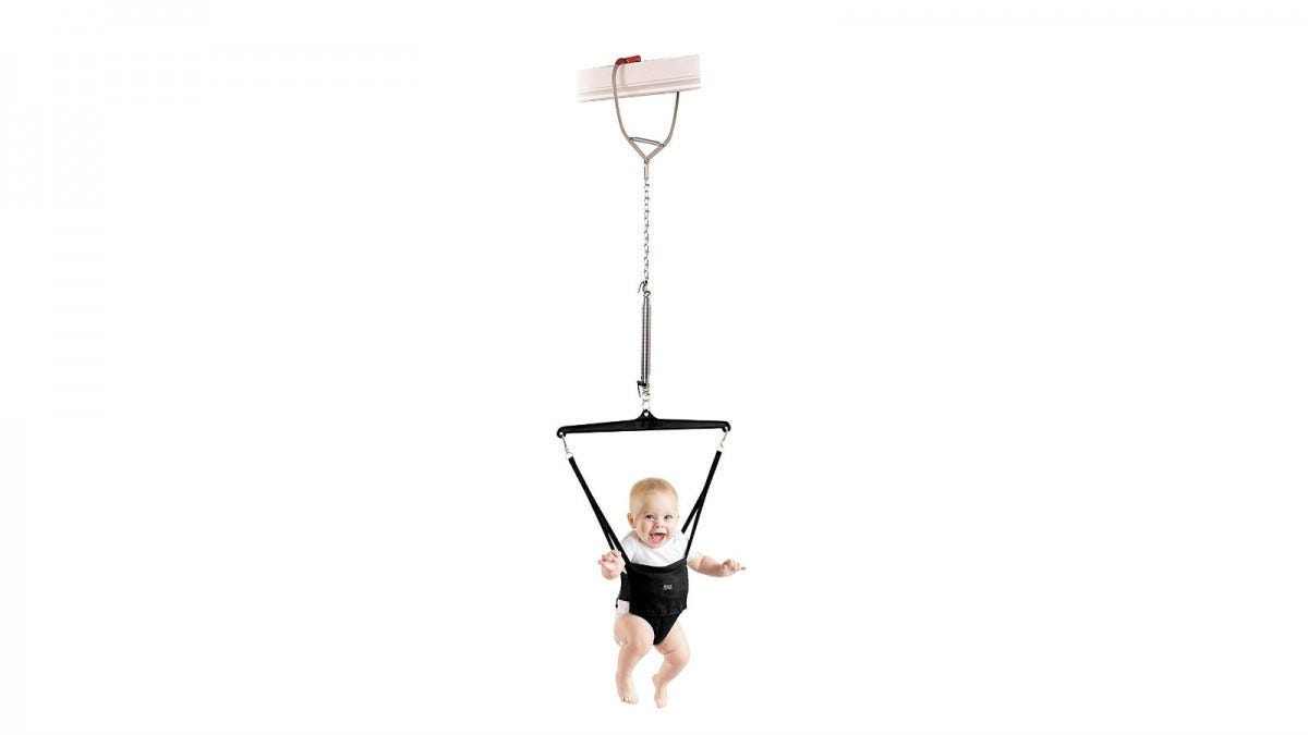 A baby in the Jolly Jumper Exerciser.