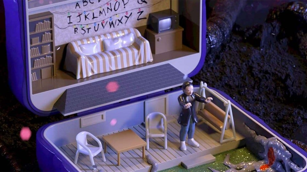 A closeup view of a CGI-rendered Polly Pocket toy set.