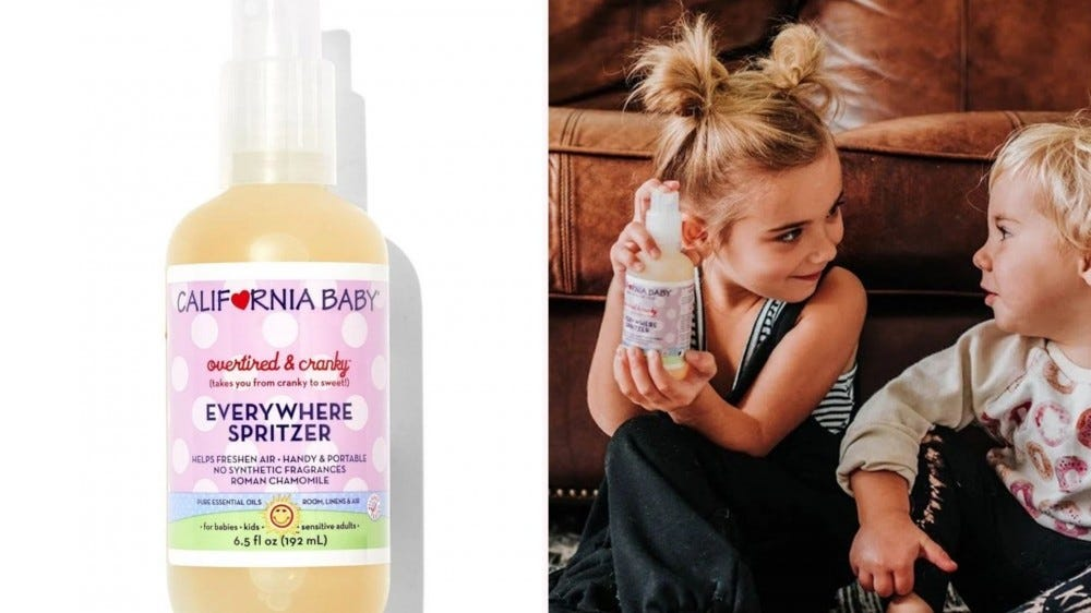A bottle of California Baby Overtired and Cranky Spritzer and a little girl showing a bottle of it to a little boy.