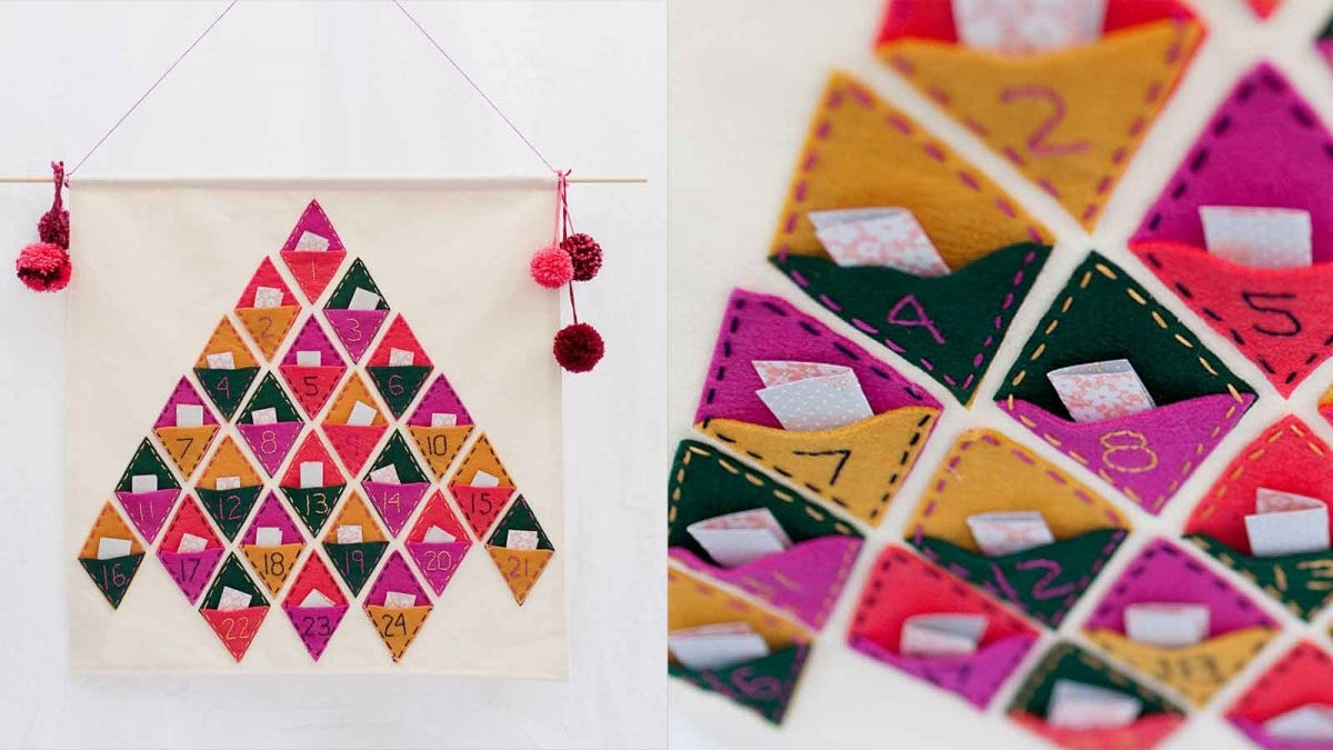 a colorful DIY felt advent calendar in the shape of a pine tree