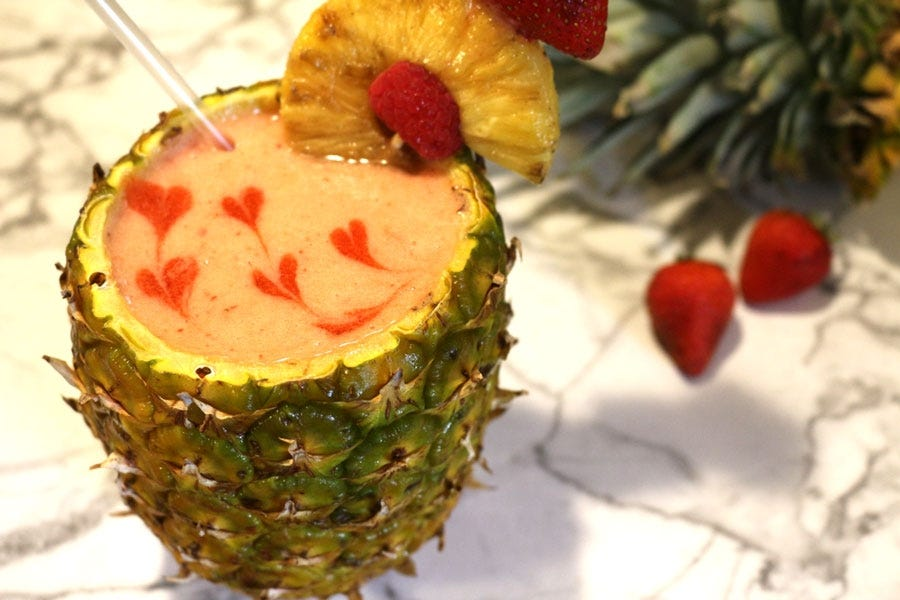 Fruit smoothie served in a cored pineapple