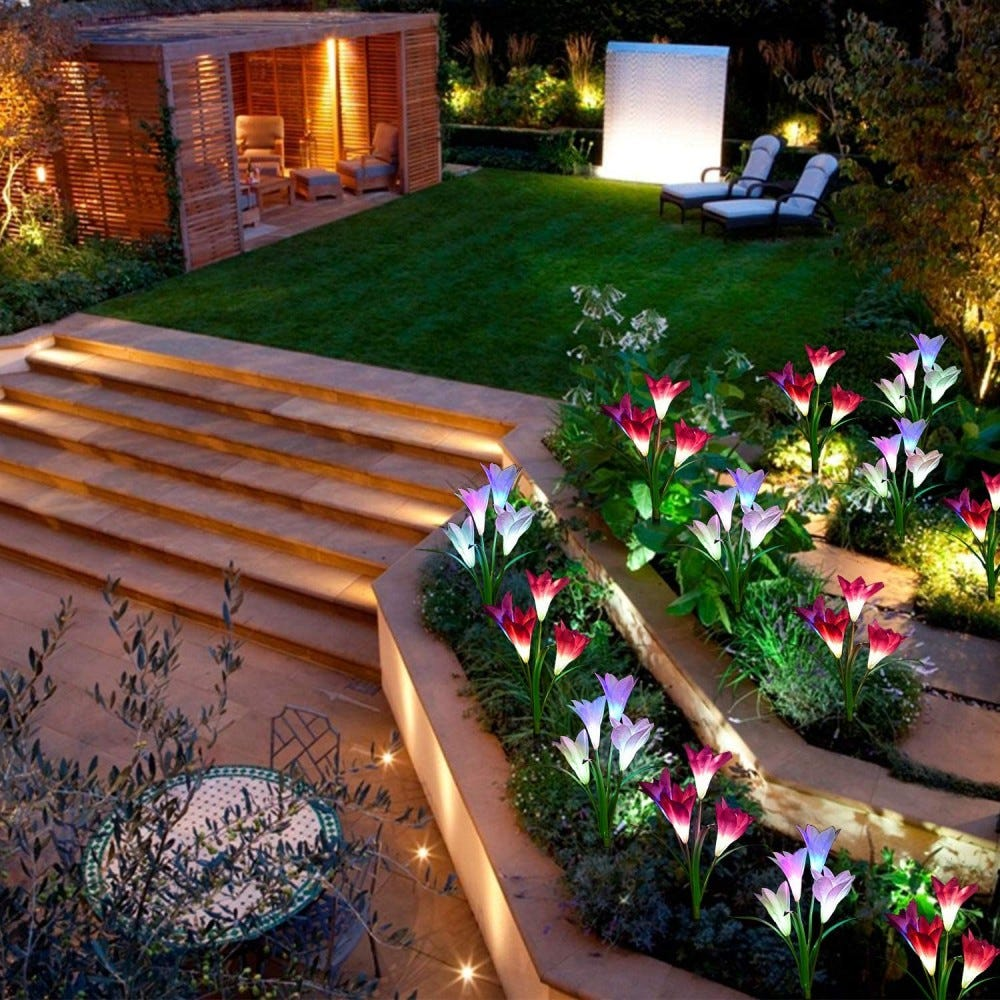 Lily Garden lights in multiple colors lining a grassy set of steps.