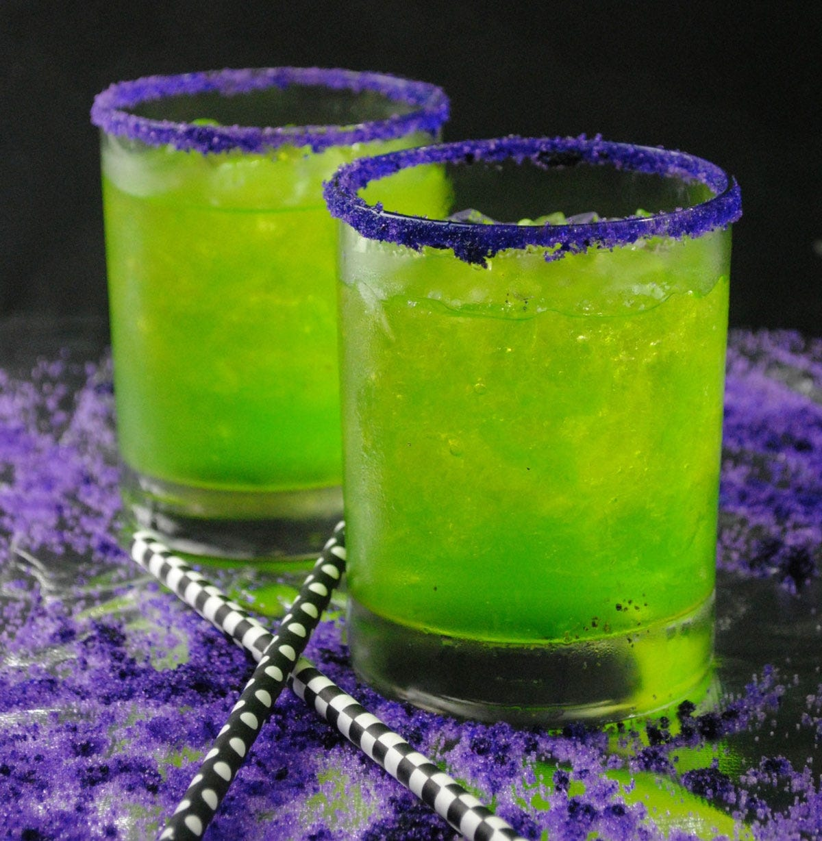 Two Joker Gone Wild cocktails with purple sugar rims.