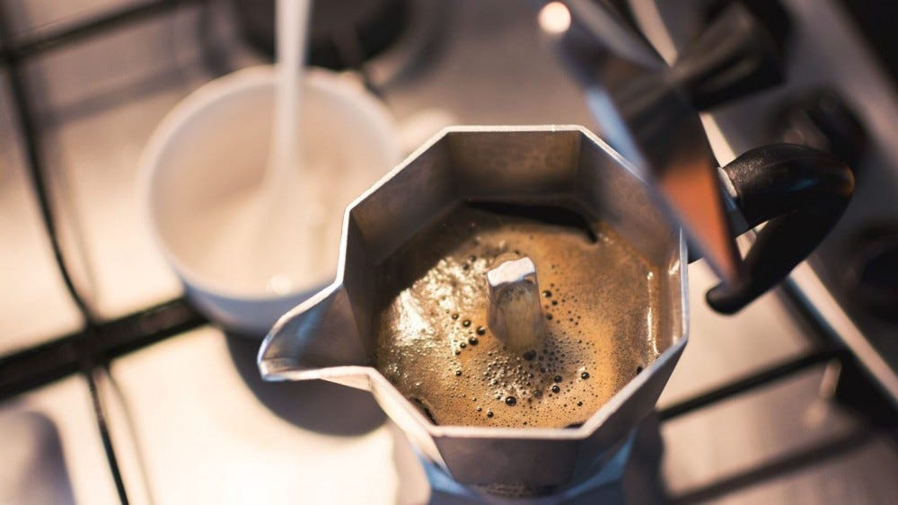 A moka coffee pot on a stove.