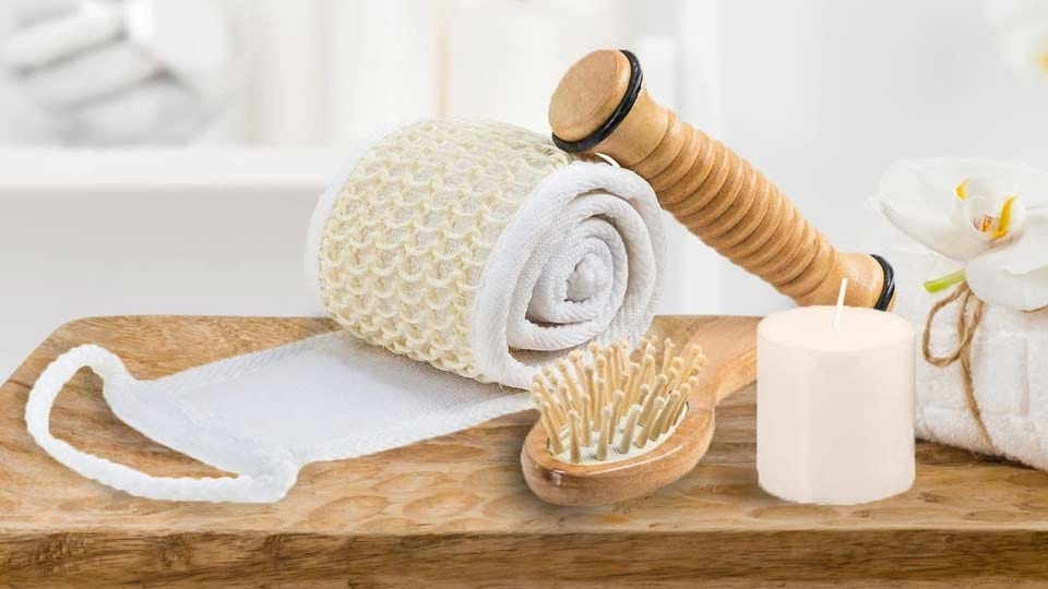 The wooden reflexology stick, massage comb, loofah, candle, and eye mask from the Frieda and Joe Massage and Reflexology Kit.