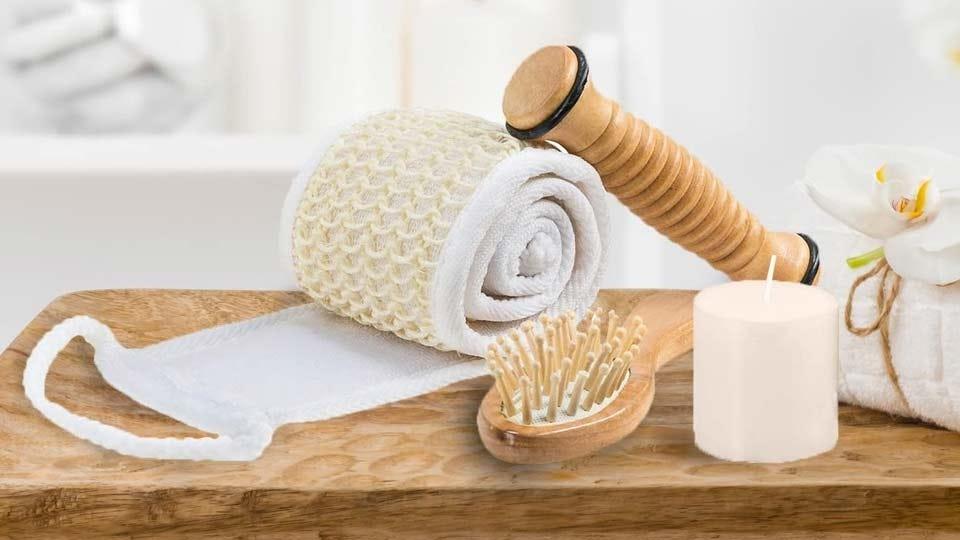 The wooden reflexology stick, massage comb, loofah, candle, and eye mask from the Frieda and Joe Massage and Reflexology Kit.