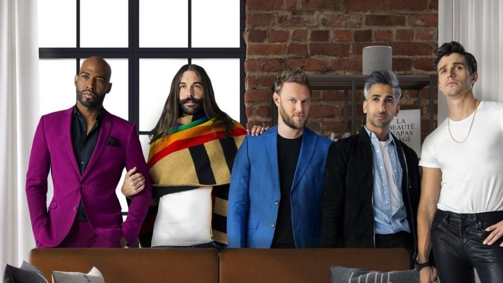 The five people of Queer Eye stand behind a couch in their new collection.