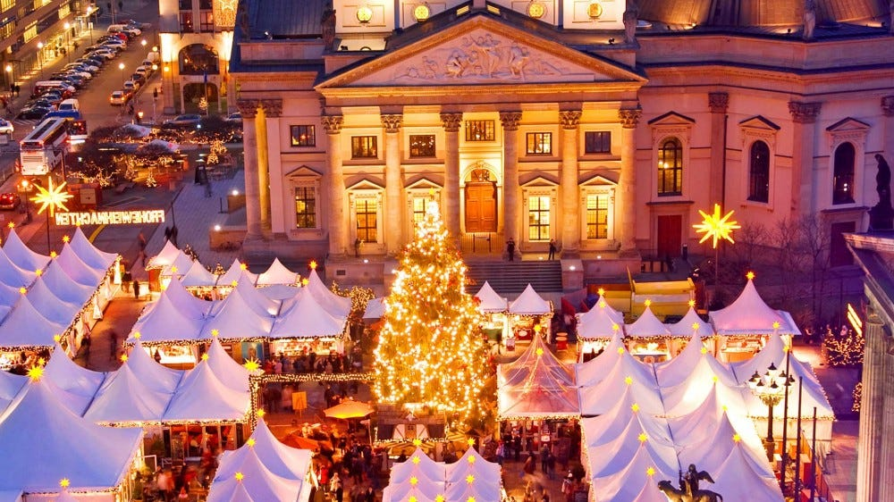 An elevated view of the festive and brightly lit Christmas Market in Berlin, Germany.