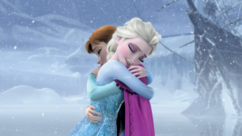 Frozen's Elsa and Anna hug in a snowstorm.