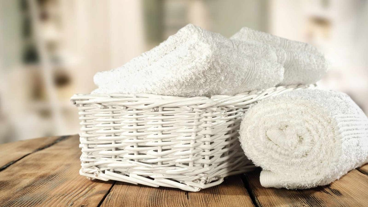 white towels rolled up in a basket