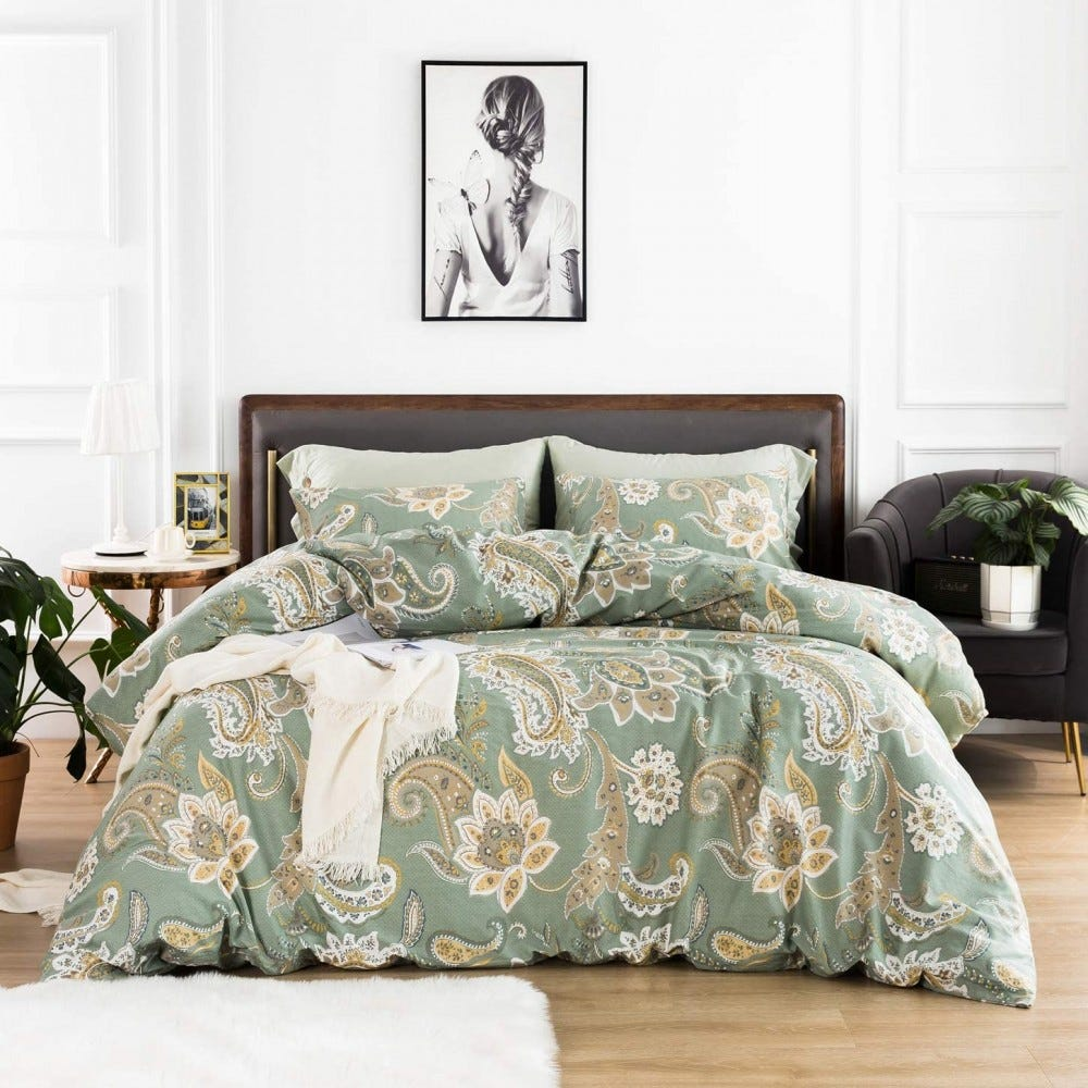 A green floral duvet cover on a full-size bed.