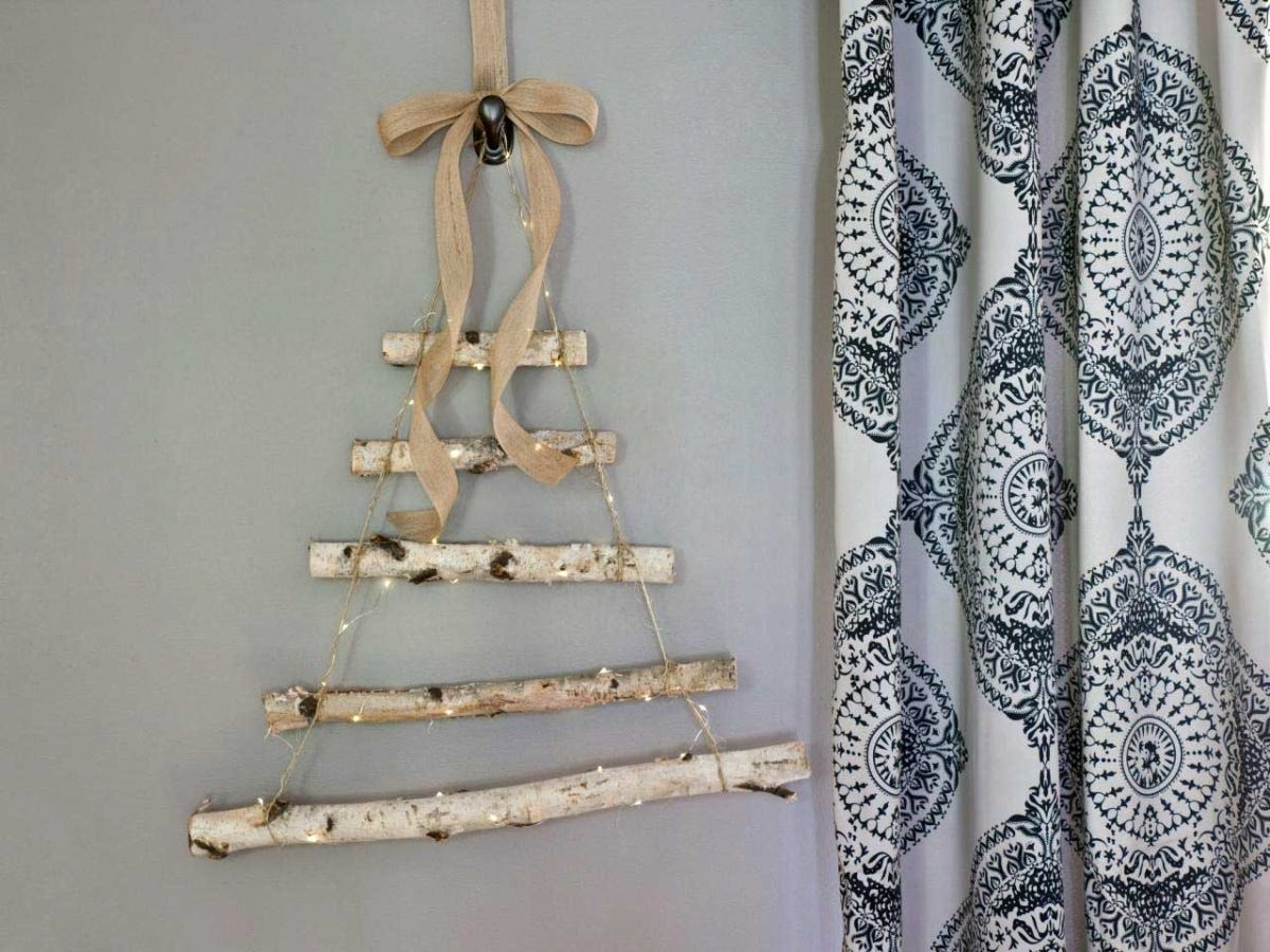 A simple hanging Christmas tree shape made from birch branches.