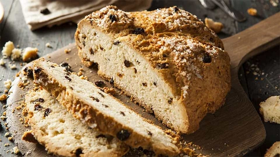 Two slices of raisin Irish soda bread.
