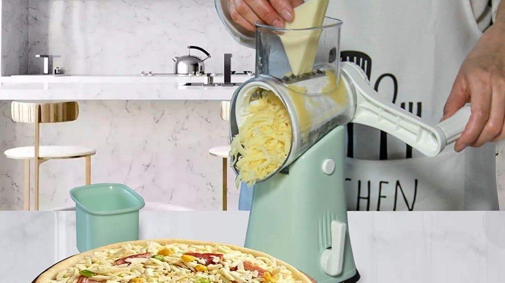 A person shredding cheese for a pizza.