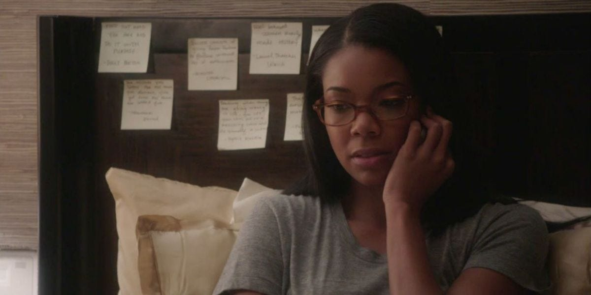 screen capture from the show Being Mary Jane showing her and her Post It Note habit