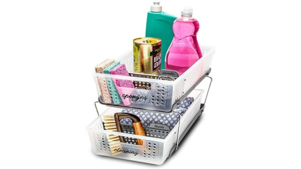 Sponges and various cleaners in the MadeSmart basket organizer.