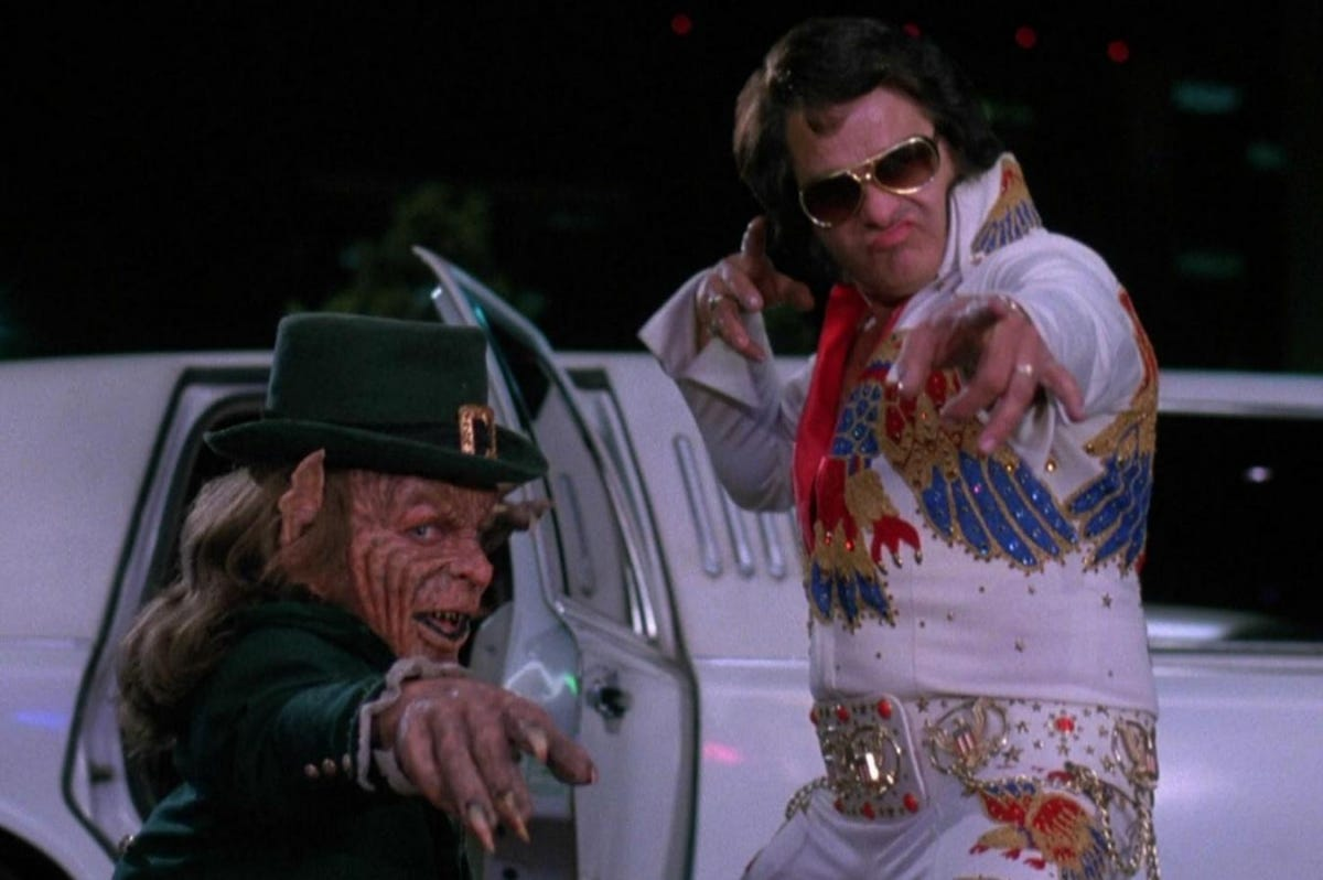 The Leprechaun hanging out with an Elvis impersonator.