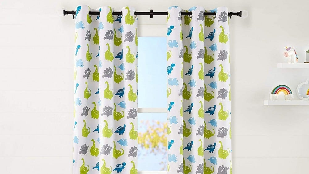 Blue, green, and gray curtains with dinosaur drawings