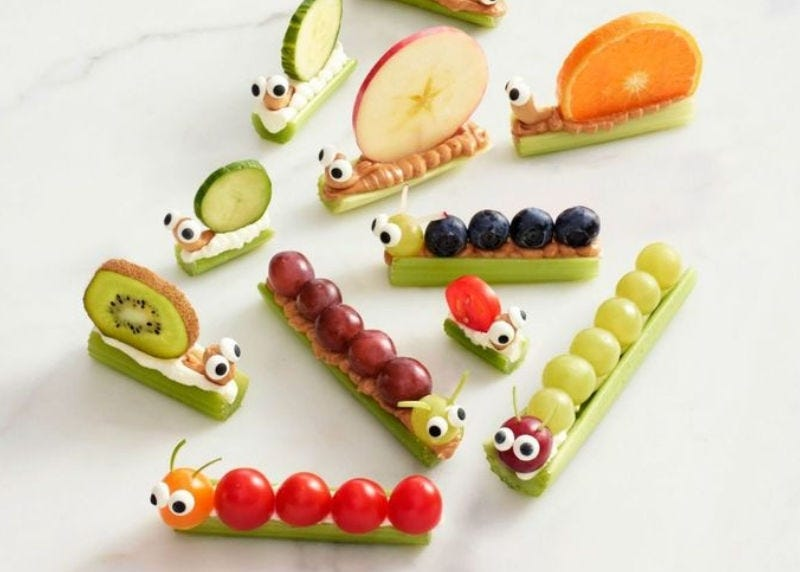 Cute caterpillars, and snails make from grapes, celery sticks, blueberries, apples and other fruits and vegetables.