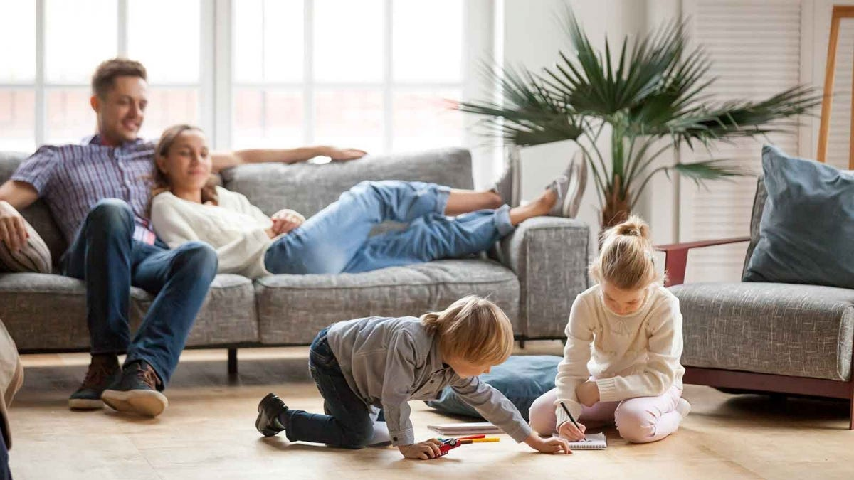 Family relaxing in a comfortable and climate controlled living room