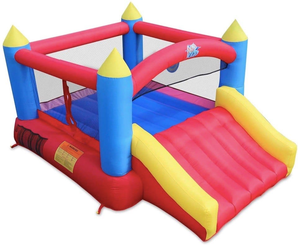Red, yellow, and blue bounce house castle with slide.