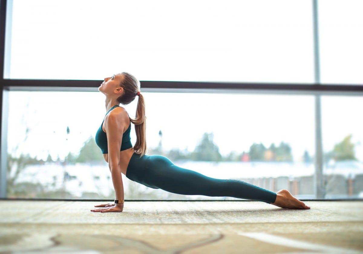 A woman in the Upward-facing dog Yoga pose.