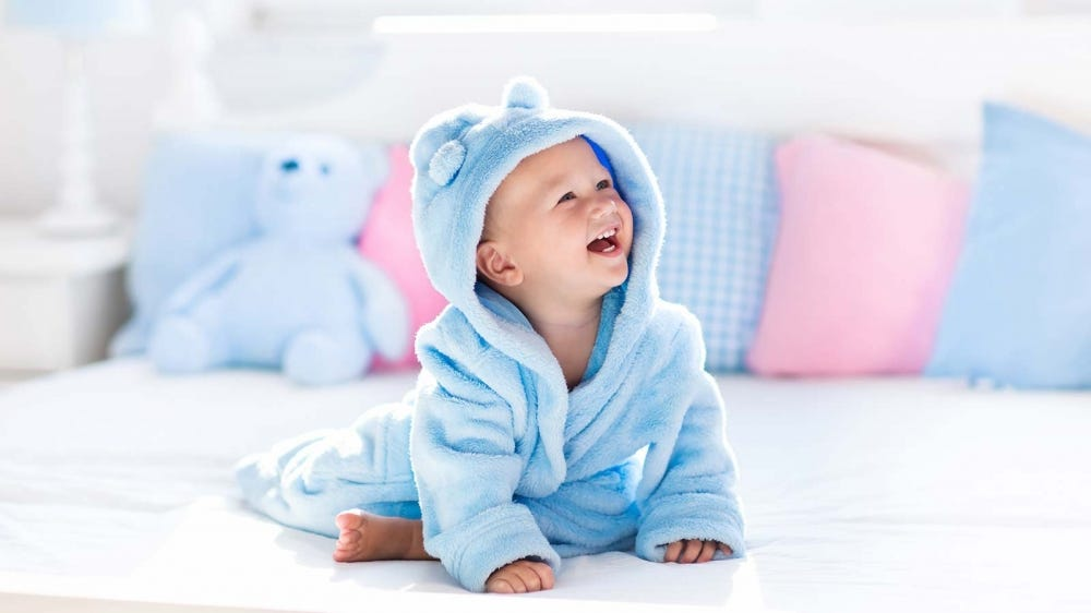 A baby wrapped in a plush animal robe.