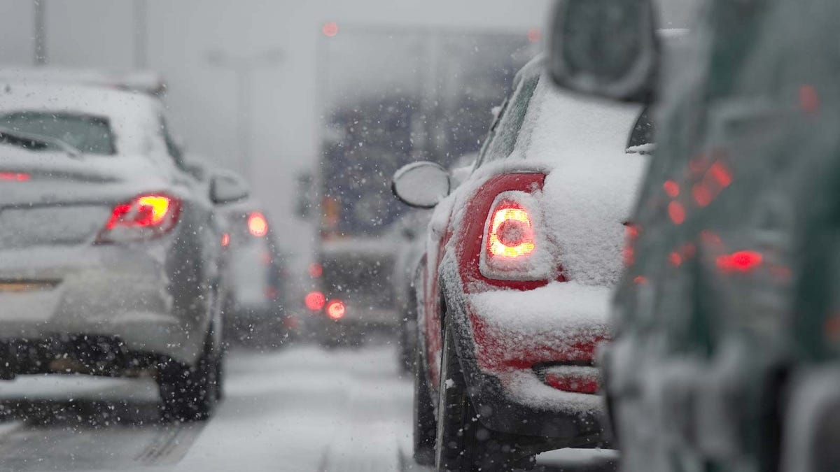 Cars stuck in traffic during a snow storm