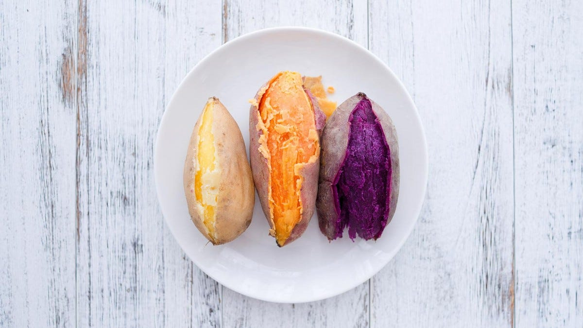 three types of sweet potatoes on a white plate