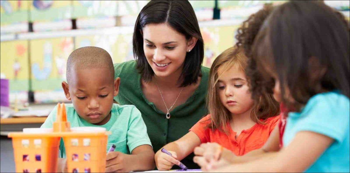 Group Of preschool Children In Art Class With Teacher