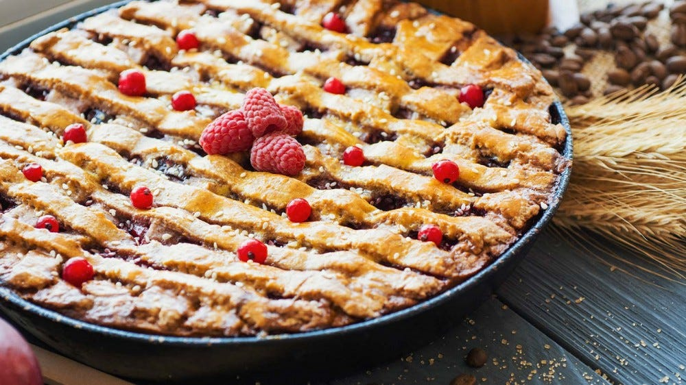 A berry pie with a golden lattice crust.