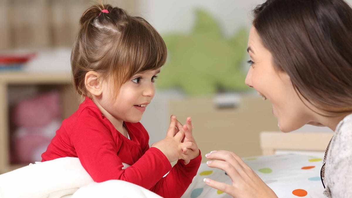 woman talking with her daughter, using positive language