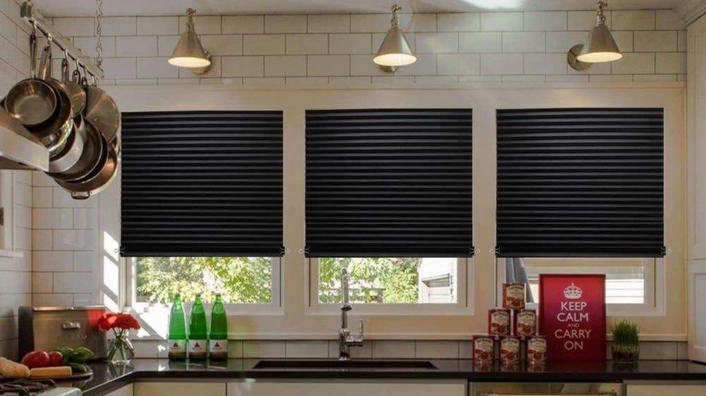 Three windows with black tones