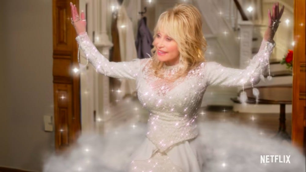 Dolly Parton stands in a foyer in a white sequined dress.