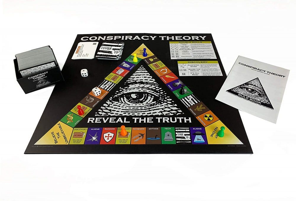 The Conspiracy Theory Trivia game board, cards, and pieces on a table.