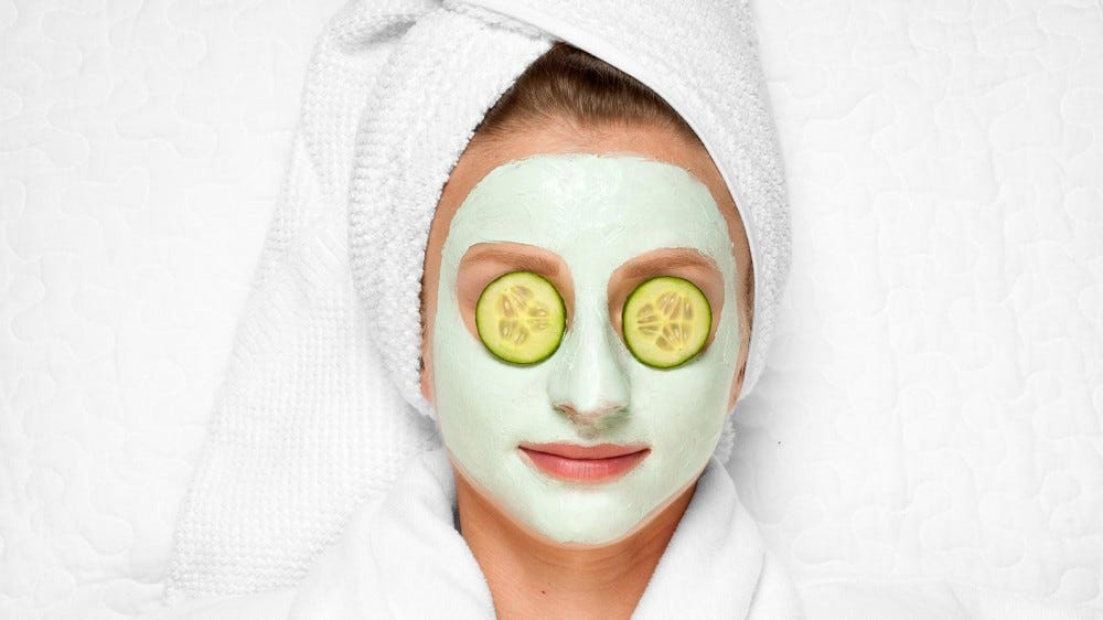 Woman with a spa mask on.