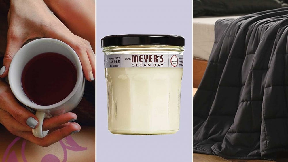 A mug of Yogi Bedtime Tea, a Mrs. Meyer's Clean Day candle, and a gray YnM weighted blanket.