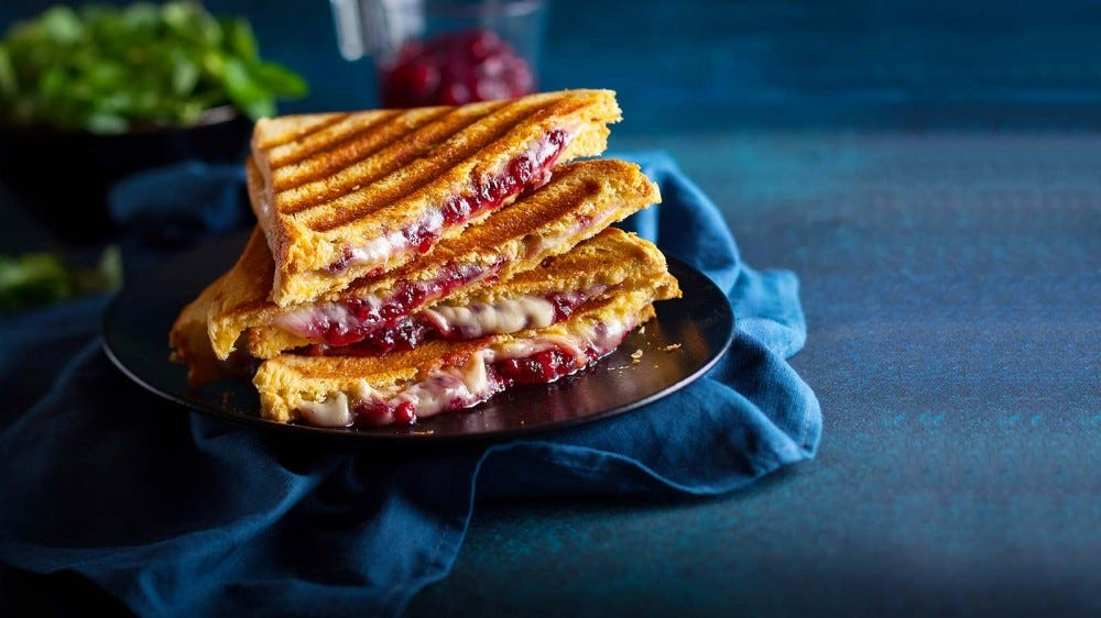 A grilled cheese sandwich enhanced with cranberry.
