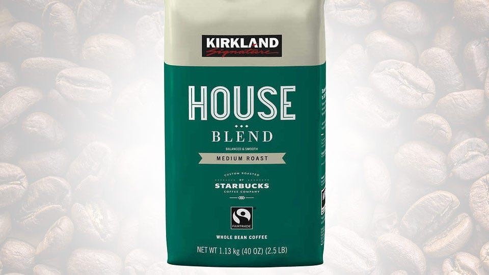 A back of Kirkland House Blend coffee against a background of coffee beans.