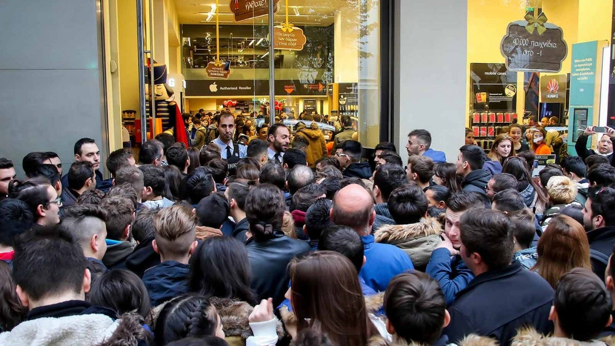 Greek shoppers pressing forward to enter a store in Greece on Black Friday