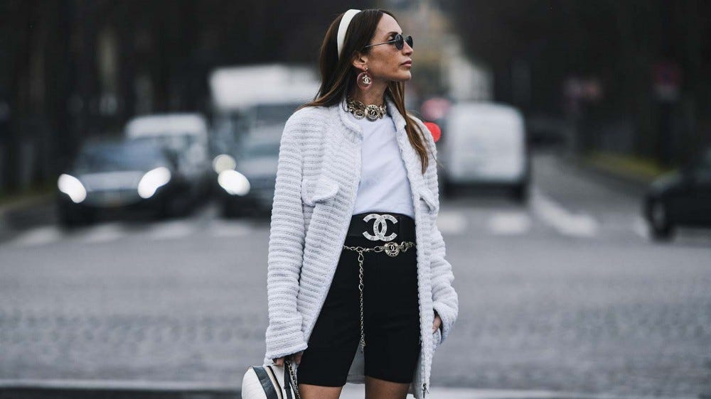 A woman wearing bike shorts as part of an outfit during the Paris Fashion Show.