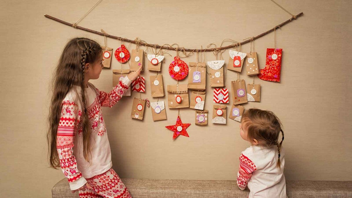 two little girls looking at a homemade DIY advent calendar