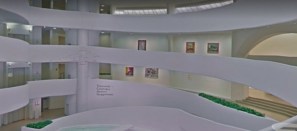 A view of multiple curving levels in an art gallery at the Guggenheim.