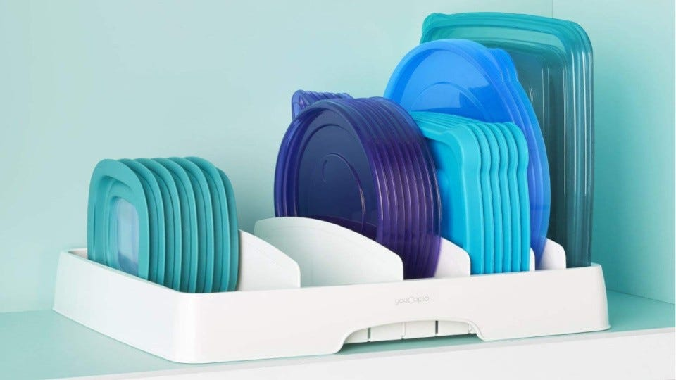 Multiple container lids sitting in a lid organizer.